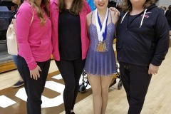 Coaches Catherine, Amy and Kim with athlete Mikayla at the 2019 International Cup Qualifier in Winnipeg, MB.